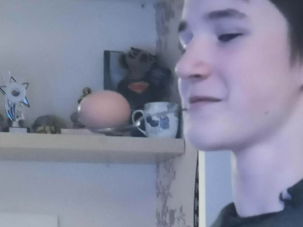 james with a spoon and egg in his mouth